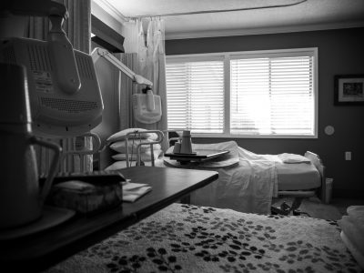 Empty hospital bed after death