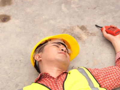 Injured worker on ground after accident